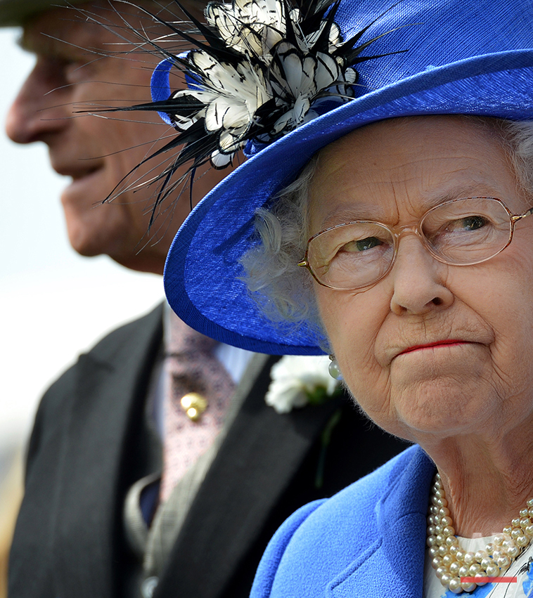 Britain's Queen Elizabeth II  and Prince Philip, left, inspect the horses in the parade ring before the Derby race at Epsom Derby, Epsom, southern England, Saturday June 2, 2012, the first official day of the Queen's Diamond Jubilee celebrations. Britain is marking Queen Elizabeth II's 60 years on the throne with a four-day holiday weekend of ceremony, symbolism and street parties.  (AP Photo/Ben Stansall, Pool)