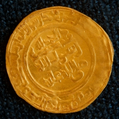 A coin dating back to the Umayyad era is displayed at the Iraqi National Museum in Baghdad, Iraq, Monday, April 4, 2013. (AP Photo/Hadi Mizban)