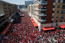 Spectators gather on East Freedom Way outside Great American Ballpark before an opening day baseball game between the Cincinnati Reds and the Philadelphia Phillies, Monday, April 4, 2016, in Cincinnati. (AP Photo/Gary Landers)