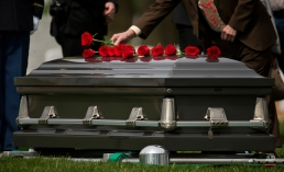 A man places a rose on the casket of U.S Army Sgt. Wilson Meckley, Jr., of Lancaster, Pa., during burial services at Arlington National Cemetery in Arlington, Va., Monday, April 4, 2016. While operating along the eastern banks of the Chosin Reservoir, elements of his unit were overwhelmed by Chinese People's Volunteer Forces and were forced to withdraw to more defensible positions at Hagaru-ri. During this withdrawal, Meckley was reported missing on Dec. 2., 1950. (AP Photo/Pablo Martinez Monsivais)