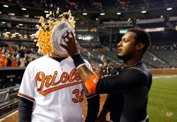 Baltimore Orioles' Adam Jones, right, hits teammate Matt Wieters in the face with a pie after an opening day baseball game against the Minnesota Twins in Baltimore, Monday, April 4, 2016. Wieters drove in the winning run on a single and Baltimore won 3-2. (AP Photo/Patrick Semansky)
