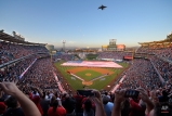 A Boeing C-17 Globemaster III flies over during the national anthem prior to an opening day baseball game between the Los Angeles Angels and the Chicago Cubs, Monday, April 4, 2016, in Anaheim, Calif. (AP Photo/Mark J. Terrill)