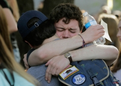 University of Texas students embrace during a gathering for fellow student Haruka Weiser on campus Thursday, April 7, 2016, in Austin, Texas. Weiser a first-year dance student from Oregon, was last seen leaving a university drama building Sunday night. Her body was discovered in a creek in the heart of the university's Austin campus on Tuesday. (AP Photo/Eric Gay)