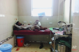 An injured victim from a suicide attack lies on a bed at a hospital in Jalalabad east of Kabul, Afghanistan, Monday, April 11, 2016. An Afghan official says that at least 12 new army recruits have been killed in a suicide bomb attack in the eastern city of Jalalabad. Ahsanullah Shinwari, head of the Jalalabad hospital, said. (AP Photo/Mirwais Rahmani)