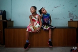In this Sept. 8, 2015 photo, best of friends Khendo Tamang, left, and Nirmala Pariyar, both 8, wait to be measured for new prosthetic legs in Kathmandu, Nepal. The girls became close friends while in recovery after each one lost a leg in Nepal's massive April 25, 2015 earthquake that killed nearly 9,000 people and injured more than 22,000. (AP Photo/Niranjan Shrestha)