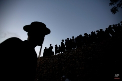 Ultra-Orthodox Jewish men gather to collect water from a spring to make matza, a traditional handmade Passover unleavened bread, near Jerusalem Thursday, April 21, 2016. Jews are forbidden to eat leavened foodstuffs during the Passover holiday. Passover celebrates the biblical story of the Israelites' escape from slavery and exodus from Egypt. (AP Photo/Sebastian Scheiner)