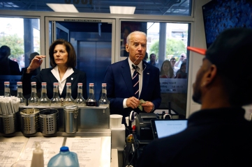 Vice President Joe Biden, right, orders an iced drink with Catherine Cortez Masto, a candidate for the U.S. Senate, Thursday, April 7, 2016, in Las Vegas. (AP Photo/John Locher)