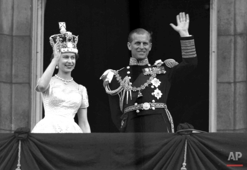 This is a June. 2, 1953 photo of Britain's Queen Elizabeth II and Prince Philip, Duke of Edinburgh, as they wave to supporters from the balcony at Buckingham Palace, following her coronation at Westminster Abbey, London. (AP Photo/Leslie Priest)
