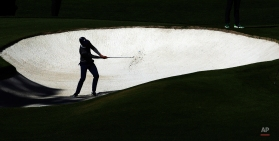 Charl Schwartzel, of South Africa, hits out of a bunker on the fourth hole during the second round of the Masters golf tournament Friday, April 8, 2016, in Augusta, Ga. (AP Photo/Charlie Riedel)