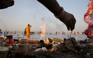 Indian Hindu devotees perform morning rituals on the banks of the Ganges River on the first day of the nine-day Hindu festival of Navratri, in Allahabad, India, Friday, April 8, 2016. Navaratri lasts for nine days, with three days each devoted to the worship of the goddess of valor Durga, the goddess of wealth Lakshmi, and the goddess of knowledge Saraswati. (AP Photo/Rajesh Kumar Singh)