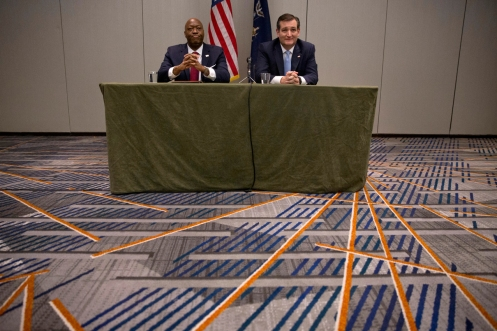 Republican presidential candidate Sen. Ted Cruz, R-Texas, right, is joined by Republican activist John Burnett as he speaks to black community leaders during a campaign event, Thursday, April 7, 2016, in New York. (AP Photo/Mary Altaffer)
