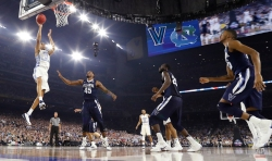 North Carolina's Brice Johnson (11) goes up for a basket during the first half of the NCAA Final Four tournament college basketball championship game against North Carolina, Monday, April 4, 2016, in Houston. (AP Photo/Eric Gay)