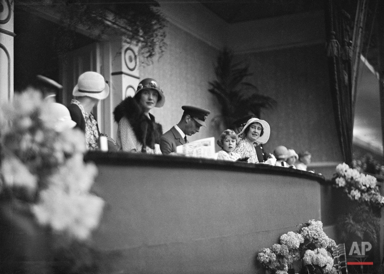 Britain's Princess Elizabeth with her parents Prince Albert and Lady Elizabeth Bowes Lyon, The Duke and Duchess of York in the RoyalBbox  for the Royal Tournament at Olympia, London on June 5, 1931. (AP Photo/Putnam)