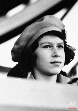 """Her Royal Highness Princess Elizabeth Alexander Mary, eldest child of the King and Queen of England, is 16-years-old on April 7, 1942. Like thousands of other children, the Princess will probably observe the occasion quietly """"somewhere in the country."""" Since the war, she has been knitting garments for the poor, contributing funds to purchase cigarettes for the armed forces and attending dances and armed forces and attending dances and programs of evacuated children. Other years it was different. In 1937 Princess in review at Portsmouth, spoke over the radio and appeared at public functions. When her parents toured American in 1939 she had the time of her life. She was appointed recently a colonel in the Grenadier Guards. (AP Photo)"""