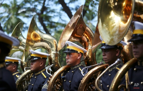 Members of the Presidential Security Group band wait for the arrival of Prince Albert II of Monaco at the Malacanang Presidential palace in Manila, Philippines on Thursday, April 7, 2016. (AP Photo/Aaron Favila)
