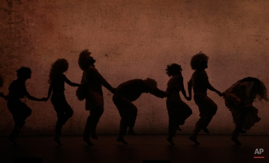 """Dancers from the Hofesh Shechter Company perform """"Sun"""" during a rehearsal at the National Theater Concert Hall in Taipei, Taiwan, Thursday, April 7, 2016. The work will be performed from April 8 ~ April 10 at the National Theater Concert Hall in Taipei. (AP Photo/Chiang Ying-ying)"""