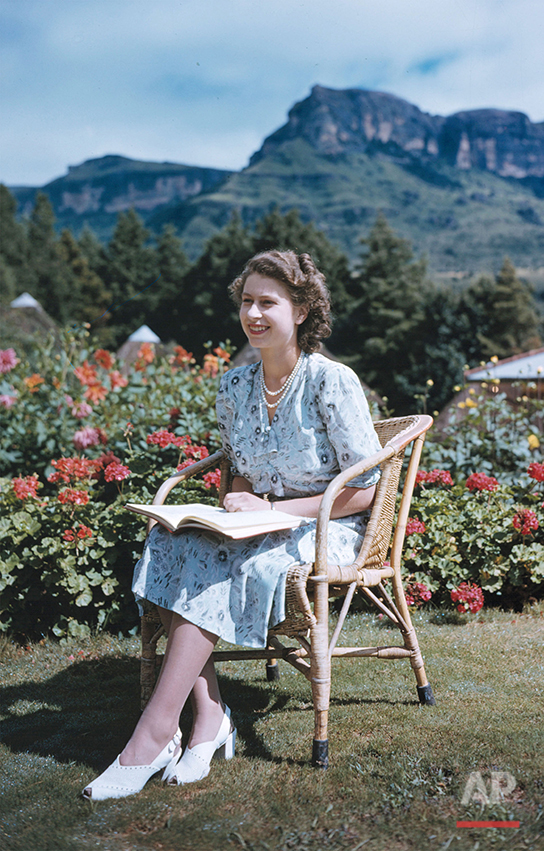 Britain's Princess Elizabeth, later Queen Elizabeth II, on her 21st birthday, seated in Natal National Park, South Africa, April 21, 1947. In the background are the Drakenberg Mountains.  (AP Photo/Eddie Worth)