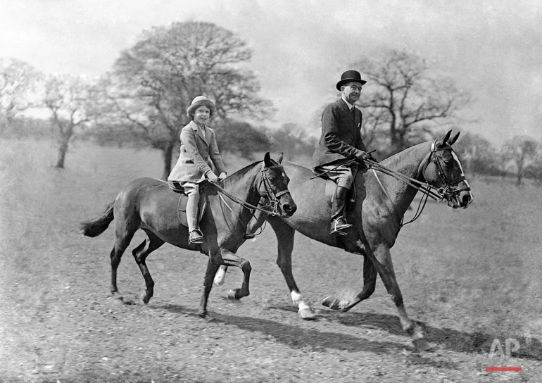 Princess Elizabeth, daughter of the Duke and Duchess of York, riding with the riding master in Windsor Great Park, Windsor, in April 1935. (AP Photo)
