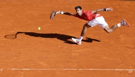 Novak Djokovic of Serbia plays a return to Jiri Vesely of Czech Republic during their match of the Monte Carlo Tennis Masters tournament in Monaco, Wednesday, April 13, 2016. (AP Photo/Lionel Cironneau)