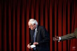 Democratic presidential candidate Sen. Bernie Sanders I-Vt., departs a campaign stop Wednesday, April 6, 2016, at Tindley Temple United Methodist Church in Philadelphia. (AP Photo/Matt Rourke)