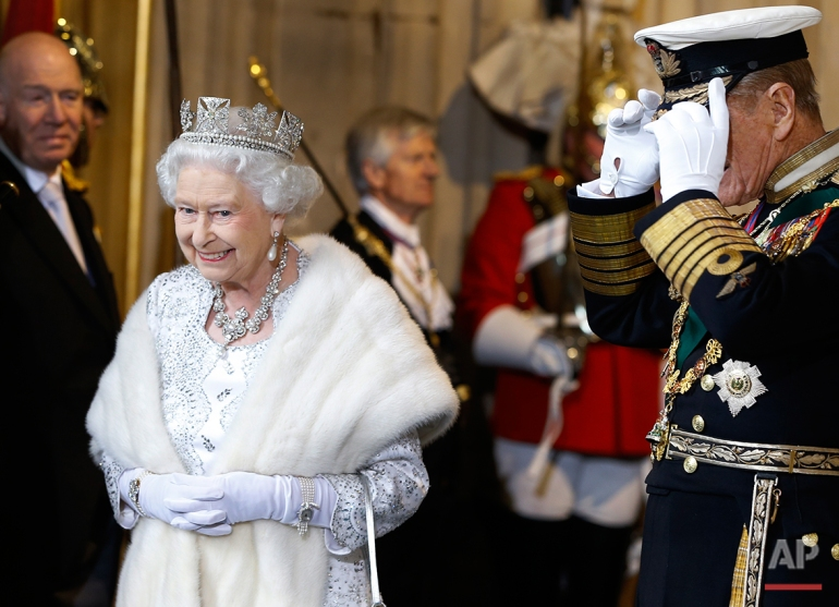 Britain's Queen Elizabeth II smiles with The Duke of Edinburgh, right, as they leave after the State Opening of Parliament, at the Houses of Parliament in London, Wednesday, May 8, 2013. The State Opening of Parliament marks the formal start of the parliamentary year, the Queen delivered a speech which  set out the government's agenda for the coming year. (AP Photo/Kirsty Wigglesworth, Pool)