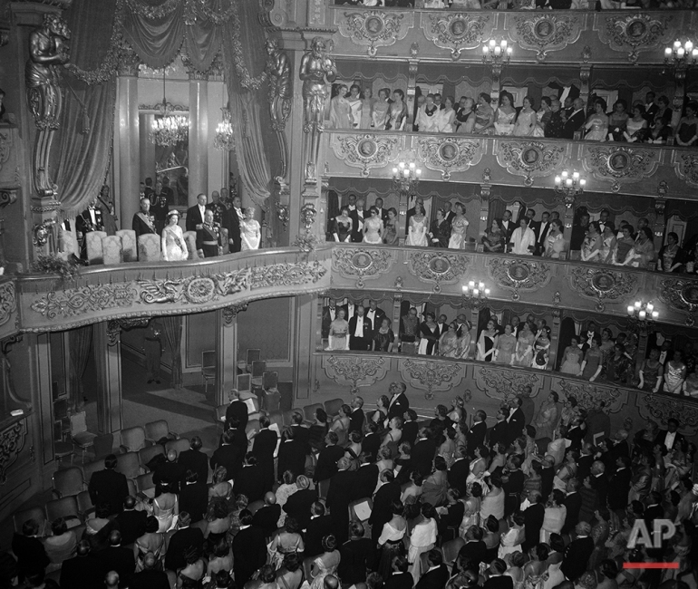 The royal box containing Queen Elizabeth II of Great Britain,  the Duke of Edinburgh and President  Francisco Craveiro Lopes, and his wife Berta, of Portugal, inside the Sao Carlos Opera House, in Lisbon, Portugal, on Feb. 19, 1957. The British royal couple were attending a gala performance in their honour, held on this the second day of their state visit to Portugal. (AP Photo)
