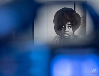 The photo of Aretha Franklin by Linda McCartney is seen behind a camera during the press preview at the exhibition 'Sixties' by Linda McCartney in the Avant-garde House of Art in Apolda, Germany, Friday, April 8, 2016. The exhibition presents the works of the photographer Linda McCartney and offers intimate insight into the private life of the McCartneys, the Beatles and other artists. The exhibition starts on April 10, 2016 and lasts until June 19, 2016. (AP Photo/Jens Meyer)
