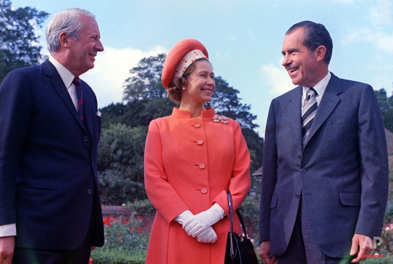 Britain's Queen Elizabeth II, pictured with U.S. President Richard Nixon, right, and Britain's Prime Minister Edward Heath at Chequers, Buckinghamshire, in 1970. (AP Photo)