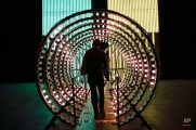 A man walk through the installation 'Y' part of the art exhibition 'Doubt', by Belgian artist Carsten Holler at the Hangar Bicocca, in Milan, Italy, Friday, April 8, 2016. (AP Photo/Luca Bruno)