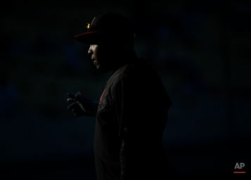 Arizona Diamondbacks left fielder Yasmany Tomas warms up prior to a baseball game against the Los Angeles Dodgers in Los Angeles, Wednesday, April 13, 2016. (AP Photo/Kelvin Kuo)