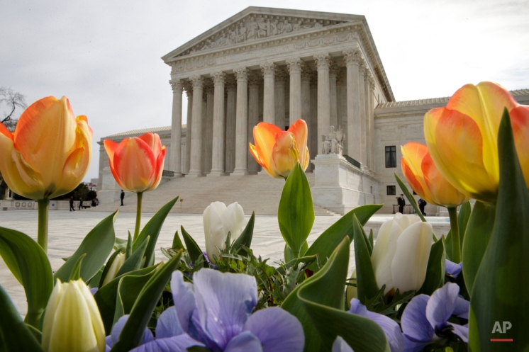 The Supreme Court is seen in Washington, Monday, April 4, 2016, after justices ruled in a case involving the constitutional principle of ìone person, one voteî and unanimously upheld a Texas law that counts everyone, not just eligible voters, in deciding how to draw legislative districts. (AP Photo/J. Scott Applewhite)