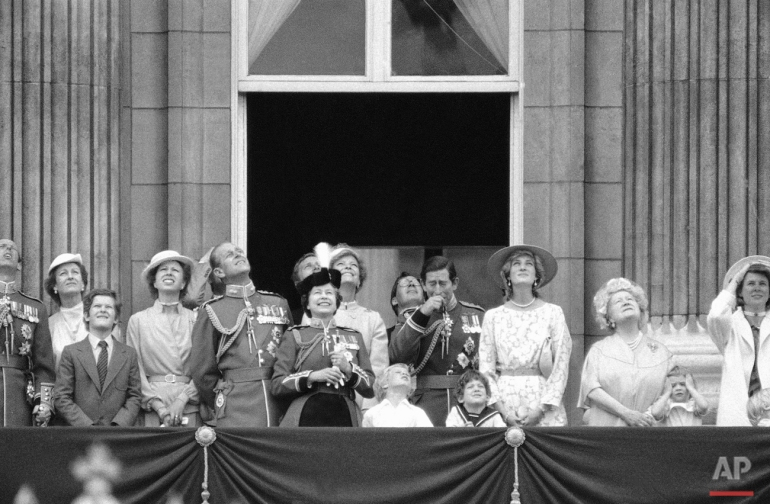 Members of the British Royal Family gathered on the balcony of London's Buckingham Palace on Saturday, June 11, 1983 watch a fly pass following the Trooping of the Colour at Horse Guards parade.  Photo shows from left to right: Prince Philip, Queen Elizabeth II, Master peter Phillips (child in open neck shirt, son of Princess Anne) the Duke of Gloucester (glasses) Prince Charles (hand to face) Lord Nicholas Windsor, (sailor suit) and the Princess of Wales. (AP Photo/ Bill Foley)