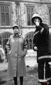Britain's Queen Elizabeth II inspects the ruins left by a fire in Windsor Castle on Saturday, Nov. 21, 1992 in Windsor, England with an unidentified fireman. The fire was still smouldering Saturday 24 hours after it started in an area of the castle and caused millions of pounds worth of damage. (AP Photo/pool/Press Association)