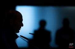 Real Madrid's head coach Zinedine Zidane, left, talks to journalists during a news conference at Real Madrid's Valdebebas training ground in Madrid, Monday, April 11, 2016. Real Madrid will play a Champions League soccer match against Wolfsburg on Tuesday. (AP Photo/Francisco Seco)