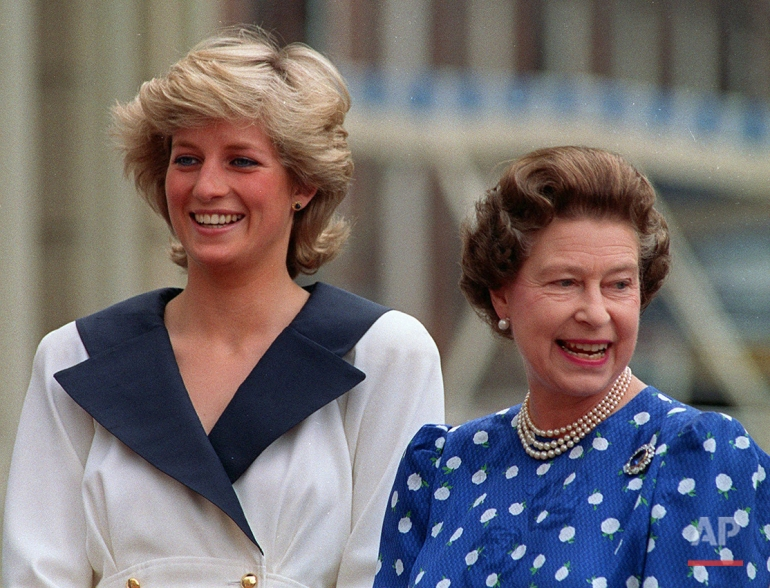 In this Aug. 4, 1987 photo, Diana, Princess of Wales, left, and Britain's Queen Elizabeth II smile to well-wishers outside Clarence House in London. Britain's Queen Elizabeth celebrates her 90th birthday on Thursday, April 21, 2016. (AP Photo/Martin Cleaver)