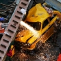 Rescue workers cut through parts of a partially collapsed overpass in Kolkata, India,Thursday, March 31, 2016. A long section of a road overpass under construction collapsed Wednesday in a crowded Kolkata neighborhood, with tons of concrete and steel slamming into midday traffic, killing several and injuring many. (AP Photo/Bikas Das)