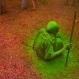 An Indian Hindu widow smeared with colors sits and watches others playing during Holi celebrations at the Gopinath temple, 180 kilometres (112 miles) south-east of New Delhi, India Monday, March 21, 2016. A few years ago this joyful celebration was forbidden for Hindu widows. Like hundreds of thousands of observant Hindu women they would have been expected to live out their days in quiet worship, dressed only in white, their very presence being considered inauspicious for all religious festivities. (AP Photo /Manish Swarup)