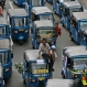 """Three-wheeled motorized taxis called """"bajaj"""" take part in a protest against competition from ride-hailing apps such as Uber and Grab at the main business district in Jakarta, Indonesia, Tuesday, March 22, 2016. Thousands of taxi drivers caused traffic chaos in the Indonesian capital Tuesday in a rowdy protest. (AP Photo/Achmad Ibrahim)"""