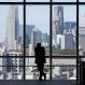 A man is silhouetted while watching toward high rise buildings at Shinjuku shopping and entertainment district in in Tokyo, Friday, March 25, 2016. (AP Photo/Koji Sasahara)