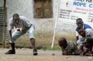 Demonstrators face off with police in the Musaga neighborhood of Bujumbura, Burundi, Wednesday May 20, 2015. (AP Photo/Jerome Delay)