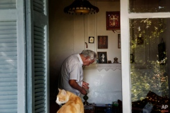 A man counts coins inside his house in the Anafiotika neighborhood in Athens, Wednesday, June 24, 2015. Prime Minister Alexis Tsipras has arrived in Brussels to meet with the heads of the International Monetary Fund, the European Central Bank and the European Union's executive Commission, the meeting is meant to smooth over some differences on the reforms that Greece proposed to creditors in exchange for rescue loans that it needs to not default on a debt payment June 30. (AP Photo/Daniel Ochoa de Olza)