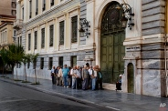 Pensioners line up as the wait to be allowed into the National Bank Of Greece in Athens, on Thursday, July 2, 2015 , and withdraw a maximum 120 euros for the week, during capital controls in Greece. Greece braced for more chaos on the streets outside its mostly shuttered banks Thursday, as Athens and its creditors halted talks on resolving the country's deepening financial crisis until a referendum this weekend. (AP Photo/Daniel Ochoa de Olza)