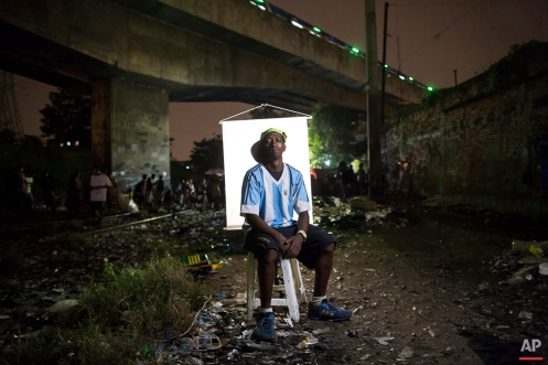 """""""Cracolandia"""" or crackland,"""" is an open-air crack cocaine market where users can buy crack, and smoke it in plain sight, day or night, in Rio de Janeiro, Brazil. This portrait series chronicles some of the people in crackland. In this March 17, 2015 photo, Sancler Rodrigues, 32, poses for a portrait in an open-air crack cocaine market, known as a """"cracolandia"""" or crackland, where users can buy crack, and smoke it in plain sight, day or night, in Rio de Janeiro, Brazil. Rodrigues said he has been smoking crack for 7 or 8 years. """"I didn't think my old black shirt would look good in your photo, so I borrowed this from friend,"""" Rodrigues said. (AP Photo/Felipe Dana)"""