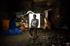 """In this March 18, 2015 photo, Patricia Sebastiao, 22, poses for a portrait in an open-air crack cocaine market, known as a """"cracolandia"""" or crackland, where users can buy crack, and smoke it in plain sight, day or night, in Rio de Janeiro, Brazil. Patricia, who has a 2-year-old daughter and 1-year-old son, is pregnant with her third child. She said she is 6 or 7 months pregnant, but was not exactly sure. (AP Photo/Felipe Dana)"""