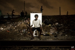 """In this March 17, 2015 photo, Jose Mauricio Oliveira, 41, poses for a portrait in an open-air crack cocaine market, known as a """"cracolandia"""" or crackland, where users can buy crack, and smoke it in plain sight, day or night, in Rio de Janeiro, Brazil. Individually, the epidemic is comprised of people from all walks of life, some of whom once held jobs, some with loving families, who harbored dreams of a better existence, all lost to their addiction. (AP Photo/Felipe Dana)"""