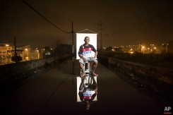 """In this March 17, 2015 photo, Eduardo Santos de Souza, 46, poses for a portrait in an open-air crack cocaine market, known as a """"cracolandia"""" or crackland, where users can buy crack, and smoke it in plain sight, day or night, in Rio de Janeiro, Brazil. Souza, a father of 8 children, with 4 different women, says he has cut down on his drug use and has a life outside crackland. (AP Photo/Felipe Dana)"""