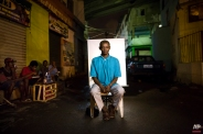 """In this March 14, 2015 photo, Jorge, 35, poses for a portrait in an open-air crack cocaine market, known as a """"cracolandia"""" or crackland, where users can buy crack, and smoke it in plain sight, day or night, in Rio de Janeiro, Brazil. Teenage mothers, truck drivers, fathers, homeless, those struggling with mental illness - all manner of person can be found in Rio's cracklands. (AP Photo/Felipe Dana)"""