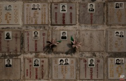 In this Monday, Nov. 30, 2015 photo, boxes of storage with niches for cremated remains are seen at a public columbarium in Hong Kong. In tightly-packed Hong Kong, the dead are causing a problem for the living. (AP Photo/Kin Cheung)