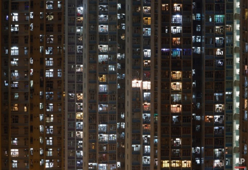 In this Tuesday, Dec. 1, 2015 photo, a general view of an apartment building in Hong Kong where both the living and the dead compete for space in the densely populated southern Chinese city. (AP Photo/Kin Cheung)