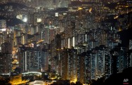 In this Friday, Nov. 27, 2015 photo, A general view of apartment buildings in Hong Kong where both the living and the dead compete for space in the densely populated southern Chinese city. (AP Photo/Kin Cheung)